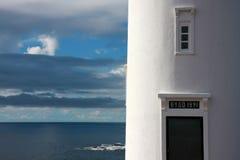 在小海岛上的灯塔在瑞典 免版税库存照片