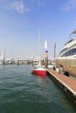 在小游艇船坞停泊的红色风船 免版税库存照片