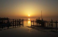 在小码头的日落 免版税库存照片