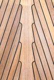 在小船的柚木树木头 免版税库存照片