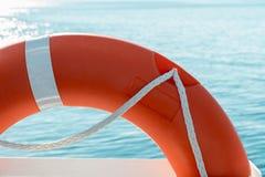 在小船的红色救护设备 免版税图库摄影