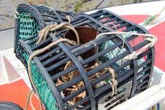 在小船的虾笼 库存图片