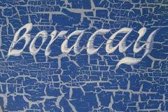 在小船边写的海岛的名字,博拉凯海岛,菲律宾 库存图片