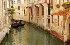 在小运河的威尼斯长平底船 免版税图库摄影
