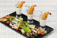 在小玻璃的各种各样的快餐 免版税图库摄影
