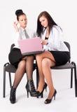 在小组的二名妇女工作 库存图片