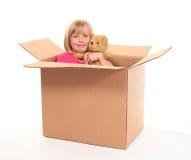 在少许开会年轻人里面的配件箱女孩 图库摄影