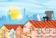 在屋顶的两只猫敬佩日出的 免版税库存图片