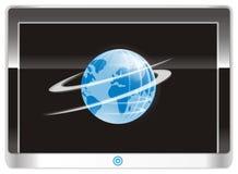 在屏幕高科技装置的地球 图库摄影