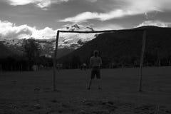 在山下的足球 免版税库存照片