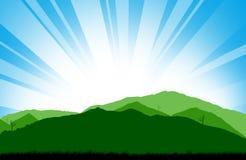在山的抽象日落与草剪影 免版税库存照片