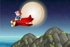 在山的试验飞行飞机在晚上 图库摄影