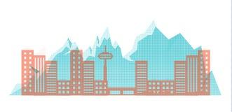 在山背景的中间影调城市的剪影  库存照片