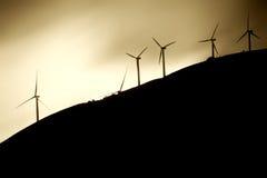 在山腰的风车 免版税库存图片