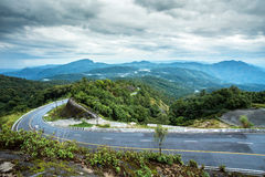 在山雨季的路,泰国 免版税库存照片