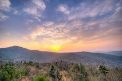 在山顶部的日出 库存图片