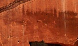 刻在岩石上的文字在圆顶礁国家公园, UT镶板 库存图片
