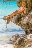 在岩石的美人鱼 图库摄影