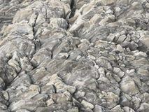 在岩石纹理,冰岛的自然玄武岩墙壁 免版税库存照片