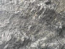 在岩石纹理,冰岛的自然玄武岩墙壁 免版税库存图片