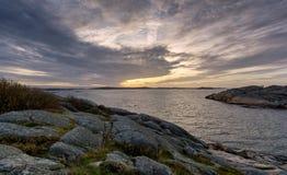 在峭壁中的落日在saltholmen哥特人 图库摄影