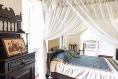 在州长` s议院博物馆里面的主要卧室,那空拍侬府的历史的旅游胜地 免版税库存照片