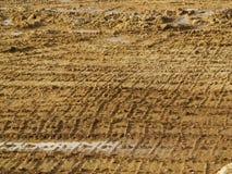 在工作地点的泥泞的轨道 免版税图库摄影