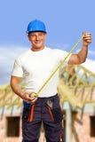 在工具白色工作者的背景 建筑 免版税库存照片
