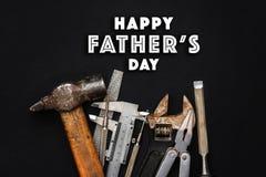 在工具的愉快的父亲` s天文本标志锤击板钳plie 免版税库存照片
