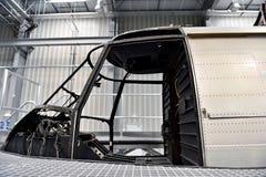 在工厂里面的直升机修理 库存照片
