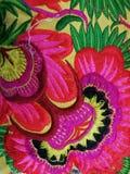 在布料的五颜六色的花 免版税库存照片