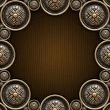 在布朗帆布的黄铜装饰品 皇族释放例证