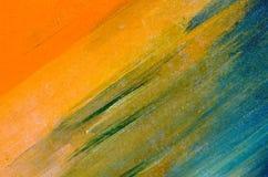 在帆布的水彩污迹:橙色,蓝色,绿色 免版税库存照片