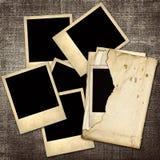 在帆布的背景的老牌照片 免版税库存照片