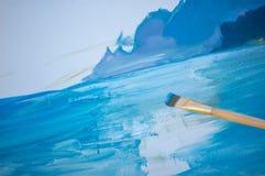在帆布绘画的凹道与画笔 库存照片