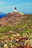 在希腊海岛mykonos的老离开的灯塔 库存照片