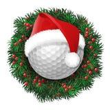在常青假日花圈的高尔夫球 免版税库存图片