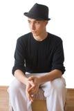 在帽子的认为的青年时期 免版税库存图片
