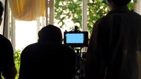 在幕后录影射击生产人员队剪影 库存照片