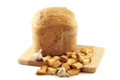 在干大蒜大面包上添面包 免版税库存照片