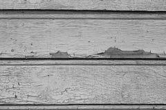 在干燥木墙壁上的老油漆 免版税库存图片