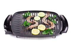 在平底锅混乱的巨型大虾油煎的 免版税库存图片