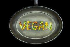 在平底锅的素食主义者词 免版税库存照片