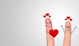 在庆祝情人节的爱的愉快的手指夫妇 免版税图库摄影