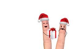 在庆祝Xmas的爱的愉快的手指夫妇 免版税图库摄影