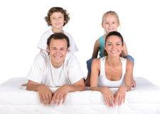 在床垫的家庭 库存图片