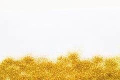 在底部的金子闪耀的闪烁背景 库存图片