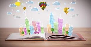 在开放书的都市风景图画 库存照片