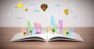 在开放书的都市风景图画 图库摄影