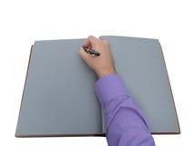 在开放老笔记本的手文字 库存照片